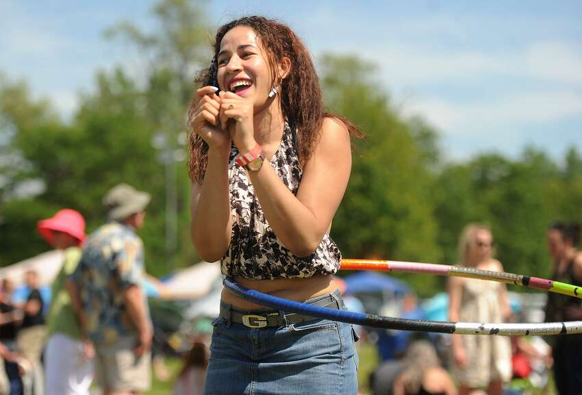 Elizabeth Estevez, of Waterbury, shows off her skills with the hula hoop at the Soupstock Music & Arts Festival at Veteran's Park in Shelton, Conn. on Sunday, June 11, 2017.