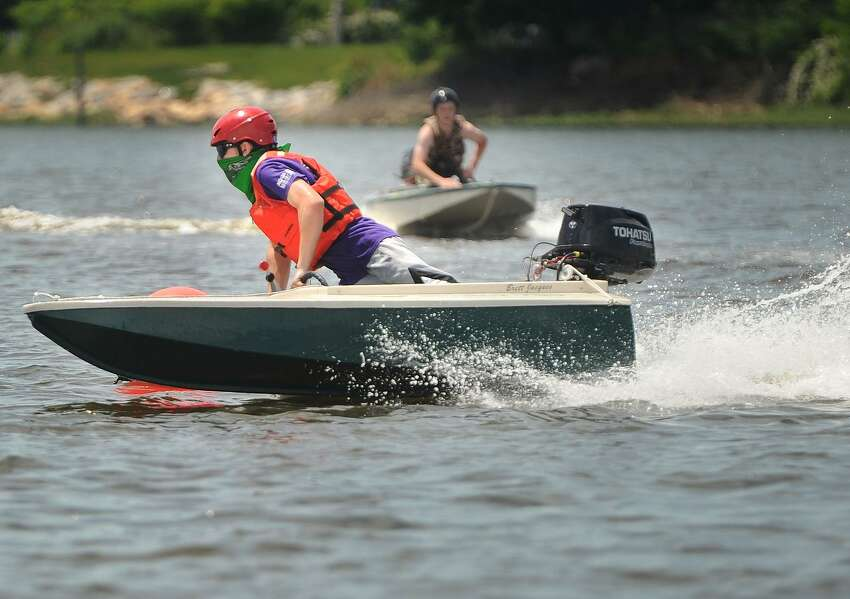 Brett Jacques, left, and John Collins, both of Trumbull, put their handmade cocktail class racing boats to the test in the 5th annual Aqua Cup boat race on Black Rock Harbor at Captain's Cove Seaport in Bridgeport, Conn. on Sunday, June 11, 2017. The two racers are friends and classmates at Bridgeport Regional Aquaculture Science and Technology Education Center. All of the boats in the race were built entirely by students from the school, which is located next to Captain's Cove.