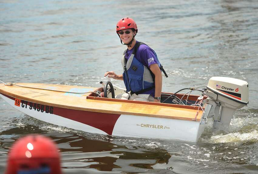 Bridgeport Regional Aquaculture Science and Technology Education Center alumni Harry Sesselberg, of Fairfield, drives his hand made cocktail class racing boat to the starting line of the 5th Annual Aqua Cup boat race on Black Rock Harbor at Captain's Cove Seaport in Bridgeport, Conn. on Sunday, June 11, 2017. All of the boats in the race were built entirely by students from the school, which is located next to Captain's Cove. Sesselberg's boat features a vintage 1970's Chrysler outboard engine.