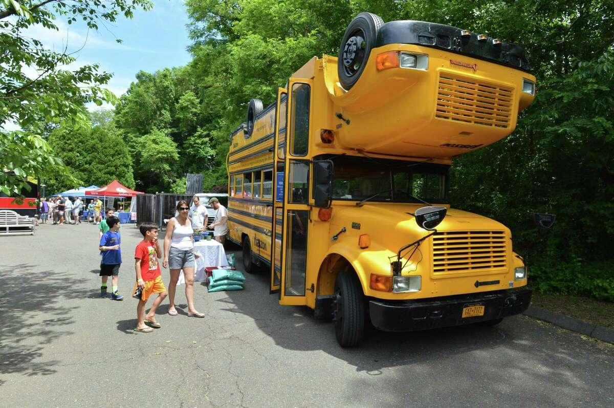 Westport's Kim Phillips takes a look at the Topsy Turvy Bus with family and friends during the Southern Connecticut Jewish Food Festival at Temple Israel in Westport on Sunday. The festival, sponsored by the Federation for Jewish Philanthropy of Upper fairfield County, included vendors and activities and a kosher food truck that were part of a day of learning about the Jewish table.
