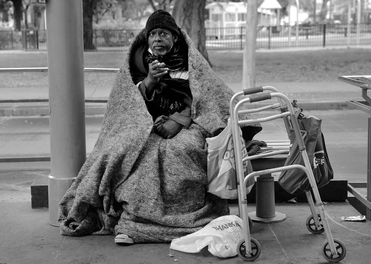 J.D. Watkins who is homeless has spent the last two weeks living at St. James Park in downtown San Jose, Ca., as seen on Friday June 9, 2017. He is seen seeking shelter under the overhang of a VTA streetcar station.