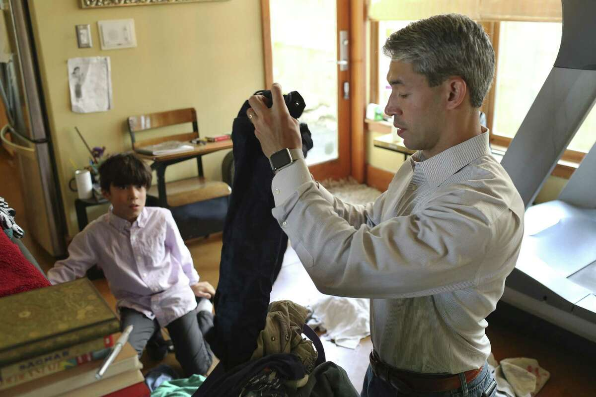 San Antonio Mayor-elect Ron Nirenberg gets his son, Jonah, 8, to pitch in with the sorting of laundry, Sunday, June 11, 2017. Nirenberg won a run off election against Mayor Ivy Taylor by a 10-point margin on Saturday. He will take office on June 22.