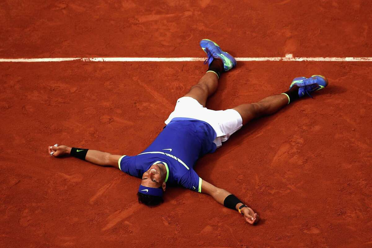 Spain's Rafael Nadal celebrates on the clay court Sunday following his victory in straight sets in the singles final over Stan Wawrinka of Switzerland at Roland Garros in Paris.