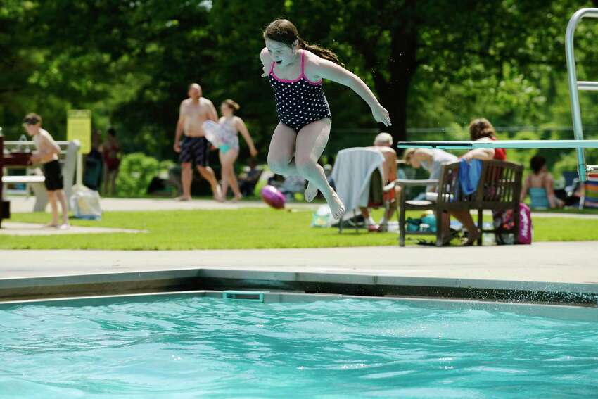 Madison Panetta, 7, jumps off the diving board and into the Bethlehem Town Pool on Sunday, June 11, 2017, in Bethlehem, N.Y. This was the first time Panetta jumped off a diving board. (Paul Buckowski / Times Union)