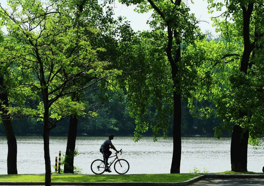 A man rides his bike along the Hudson River bike path on Sunday, June 11, 2017, in Albany, N.Y.   (Paul Buckowski / Times Union)