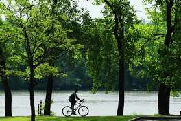 A man rides his bike along the Hudson River bike path on Sunday, June 11, 2017, in Albany, N.Y.   (Paul Buckowski / Times Union)