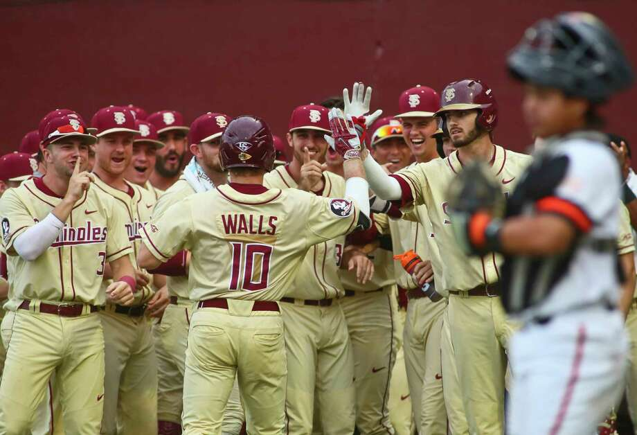 Florida State's Taylor Walls (10) is congratulated by teammates in the first after hitting the first of his two homers in Sunday's rout of Sam Houston State. Photo: Phil Sears, FRE / FR170567 AP