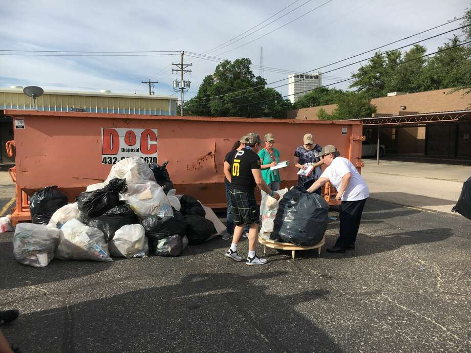 Midland County employees work at the weigh-in site for the Pick-Up Midland County trash challenge on May 26. Photo: Courtesy Photo