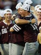 Infielder Joel Davis, right, and coach Rob Childress are embracing Texas A&M's first trip to the College World Series since 2011.