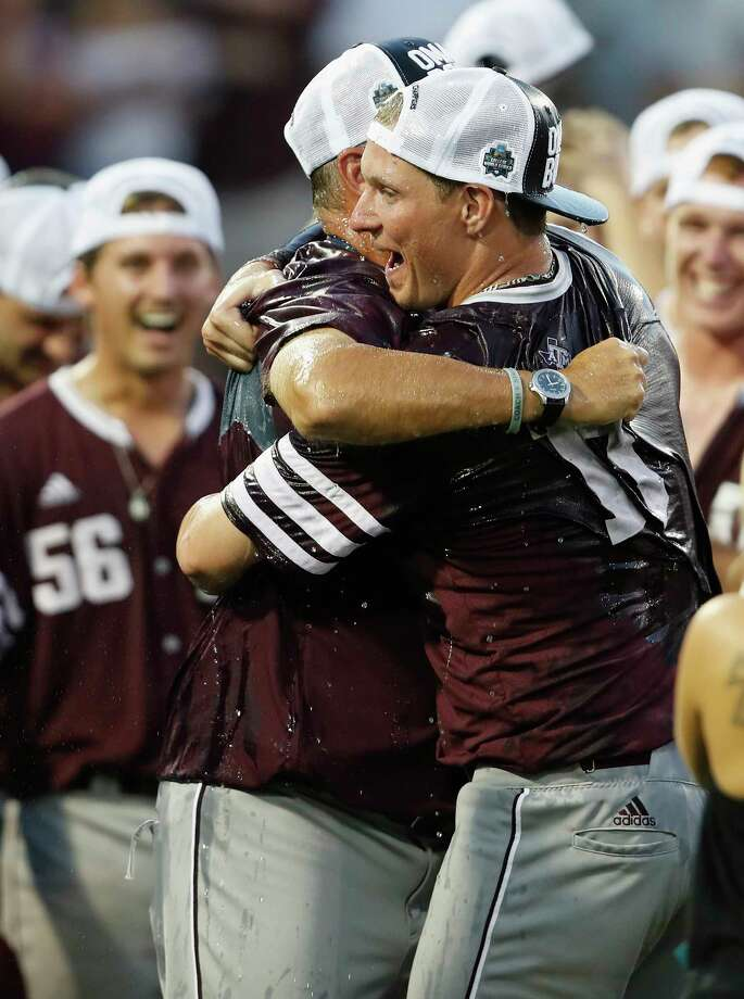 Infielder Joel Davis, right, and coach Rob Childress are embracing Texas A&M's first trip to the College World Series since 2011. Photo: Tim Warner, Freelance / Houston Chronicle