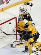 Pittsburgh Penguins' Patric Hornqvist (72), of Sweden, scores a goal against Nashville Predators goalie Pekka Rinne, of Finland, during the third period of Game 6 of the NHL hockey Stanley Cup Final, Sunday, June 11, 2017, in Nashville, Tenn. (AP Photo/Jeff Roberson)
