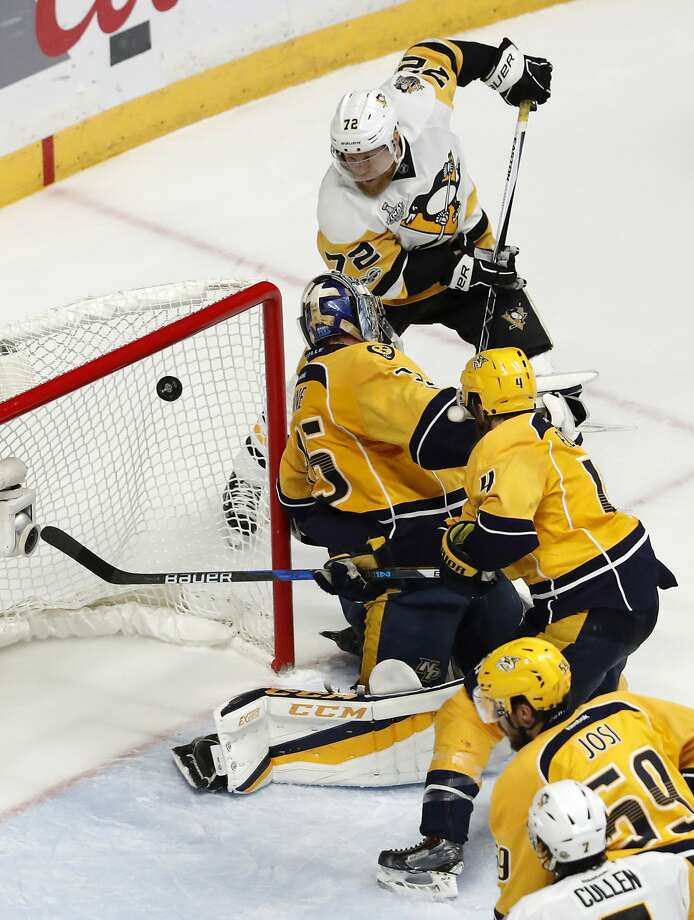 The Penguins' Patric Hornqvist banks a shot off goalie Pekka Rinne into the net late in the third period for the winner. Photo: Jeff Roberson, Associated Press
