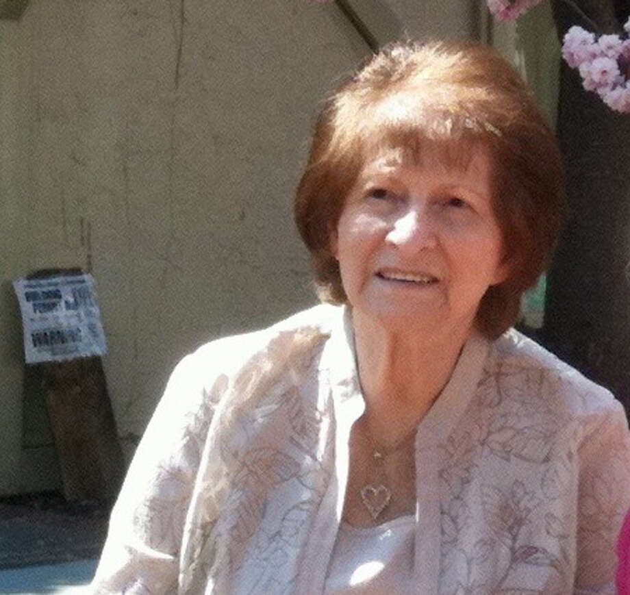 "This May 8, 2011 photo provided by Bob Dennis shows a family photo of Marie Barbuto. By the time Roseann Keiles realized a scam artist had his hooks in her mother, Barbuto, the damage was done. The 82-year-old Long Island woman, who had Alzheimer's disease, had mailed away thousands of dollars in little envelopes to a man calling himself ""Mr. Cashman"" who phoned every day asking for money. A bill now under consideration in New York's legislature would give banks the ability to temporarily freeze the accounts of older adults when they notice activity uncharacteristic of a person's normal spending habits. (Bob Dennis via AP) ORG XMIT: NYR103 Photo: Bob Dennis / Bob Dennis"