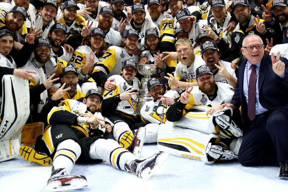 NASHVILLE, TN - JUNE 11:  The Pittsburgh Penguins pose for a group photo with the Stanley Cup Trophy after they defeated the Nashville Predators 2-0 in Game Six of the 2017 NHL Stanley Cup Final at the Bridgestone Arena on June 11, 2017 in Nashville, Tennessee.  (Photo by Bruce Bennett/Getty Images) Photo: Bruce Bennett, Getty Images