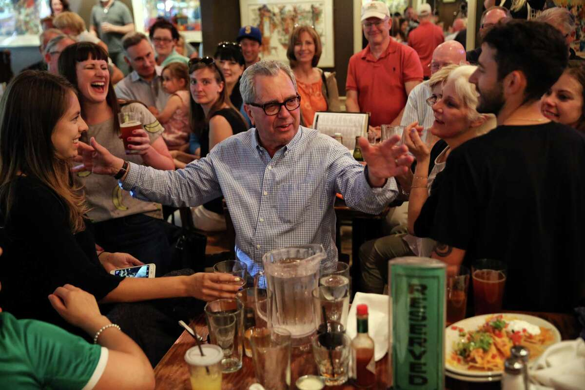 """Co-founder Mick McHugh, center, addresses the friends and family filling the bar as F.X. McRory's hosts an """"Irish wake"""" goodbye party on their last day in the historic Pioneer Square location where they opened 40 years ago, Sunday, June 11, 2017. The bar will be moving to a smaller location a few blocks away."""