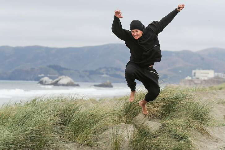 Third Eye Blind lead singer Stephan Jenkins jumps off of a dune during a portrait session at Ocean Beach in San Francisco, California, on Wednesday, May 24, 2017.