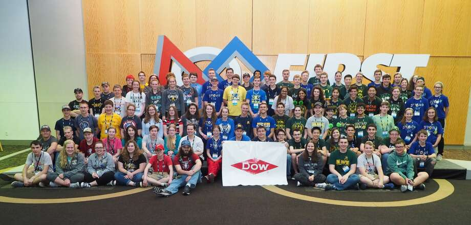 Local FIRST Robotics Teams pose for a photo during the FIRST Robotics Championship in St. Louis, Missouri, in April.