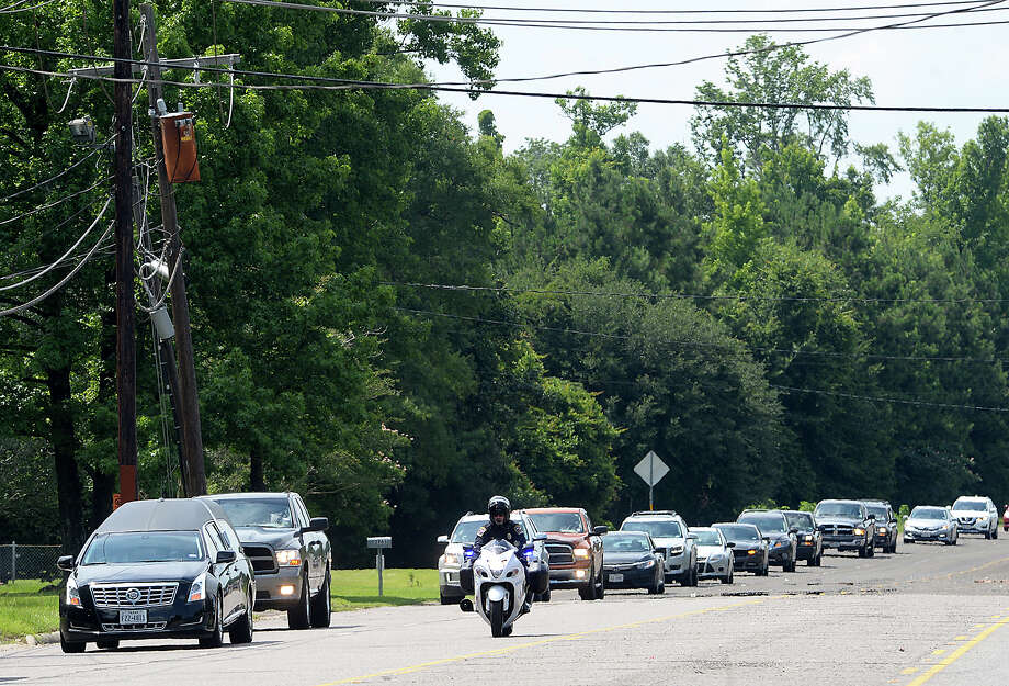 The funeral procession makes its way down N. Main Street toward Restlawn Cemetery following funeral services at Turning Point Church in Vidor Friday.  Photo taken Friday, June 9, 2017 Kim Brent/The Enterprise Photo: Kim Brent / BEN
