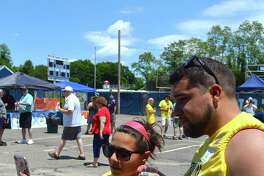 Eleni Stefanatos and Jim Piazza, both of Stratford and both alums, grab a phone picture at the Bacon and Beer Festival at Notre Dame High School, Saturday, June 10, 2017, in Fairfield, Conn.