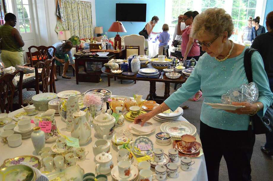 Connie Meehan of Stamford explores the spread at the St. Luke's Parish annual Tag Sale, Saturday, June 10, 2017, in Darien, Conn. Photo: Jarret Liotta / For Hearst Connecticut Media / Darien News Freelance