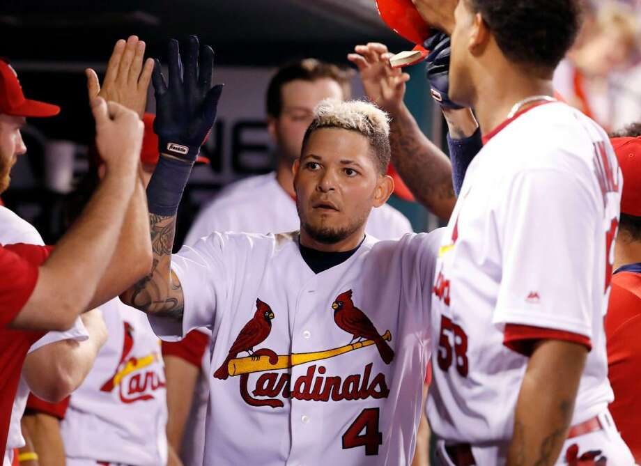 St. Louis Cardinals' Yadier Molina (4) is congratulated by teammates after hitting a solo home run during the eighth inning of a baseball game against the Los Angeles Dodgers Tuesday, May 30, 2017, in St. Louis. Photo: Jeff Roberson /Associated Press