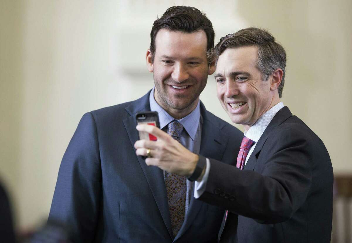 Texas state Sen. Van Taylor, R-Plano, taking a selfie with former Dallas Cowboys quarterback Tony Romo in 2017, is a retired Marine who fought in Iraq.