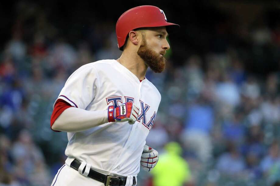 Texas Rangers' Jonathan Lucroy legs out a basehit on May 11. Photo: Tony Gutierrez /Associated Press / Copyright 2017 The Associated Press. All rights reserved.