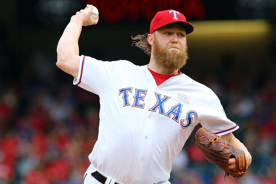 Andrew Cashner of the Texas Rangers pitches against Houston on June 3. The Astros swept the series. Photo: Rick Yeatts /Getty Images / 2017 Getty Images