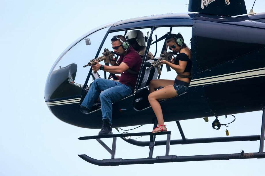 HeliBacon, an aerial helicopter company, offers hunters the chance to shoot down feral hogs from the sky. Their most exclusive trip is priced at $30,000. Photo: HeliBacon
