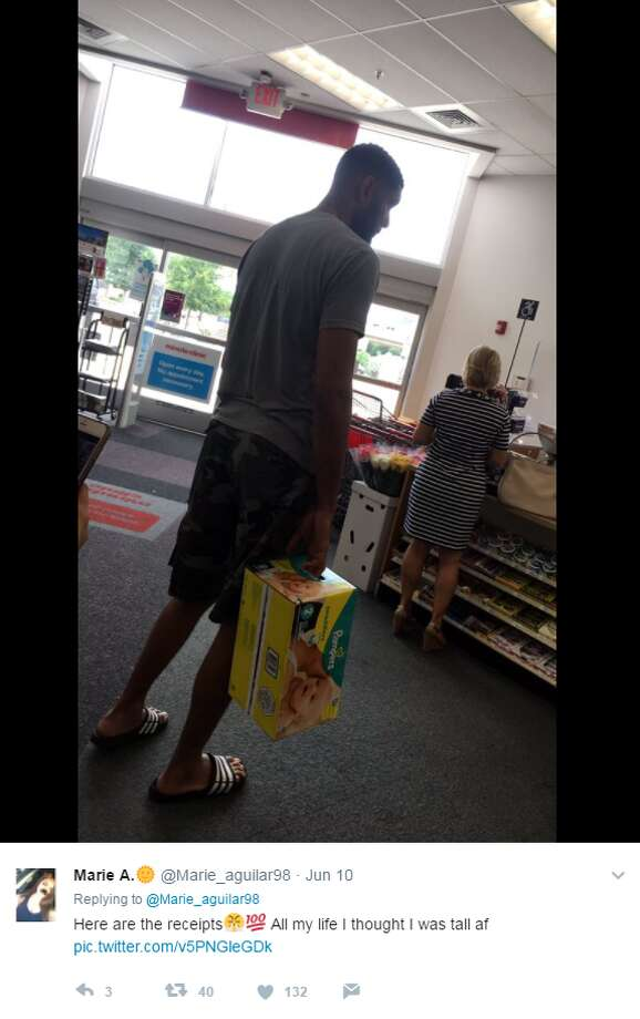 photo tim duncan in line at s a area drug store with box of size 2
