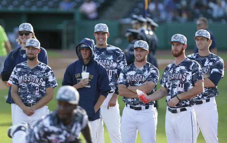 Pitching staff of the San Antonio Missions watch starter Enyel go thru his warm-ups on on June 7, 2017. Photo: Ron Cortes /For The Express-News