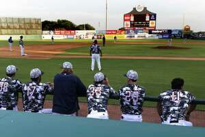 Pitching staff of San Antonio Missions watch the game from the dugout on June 7, 2017.