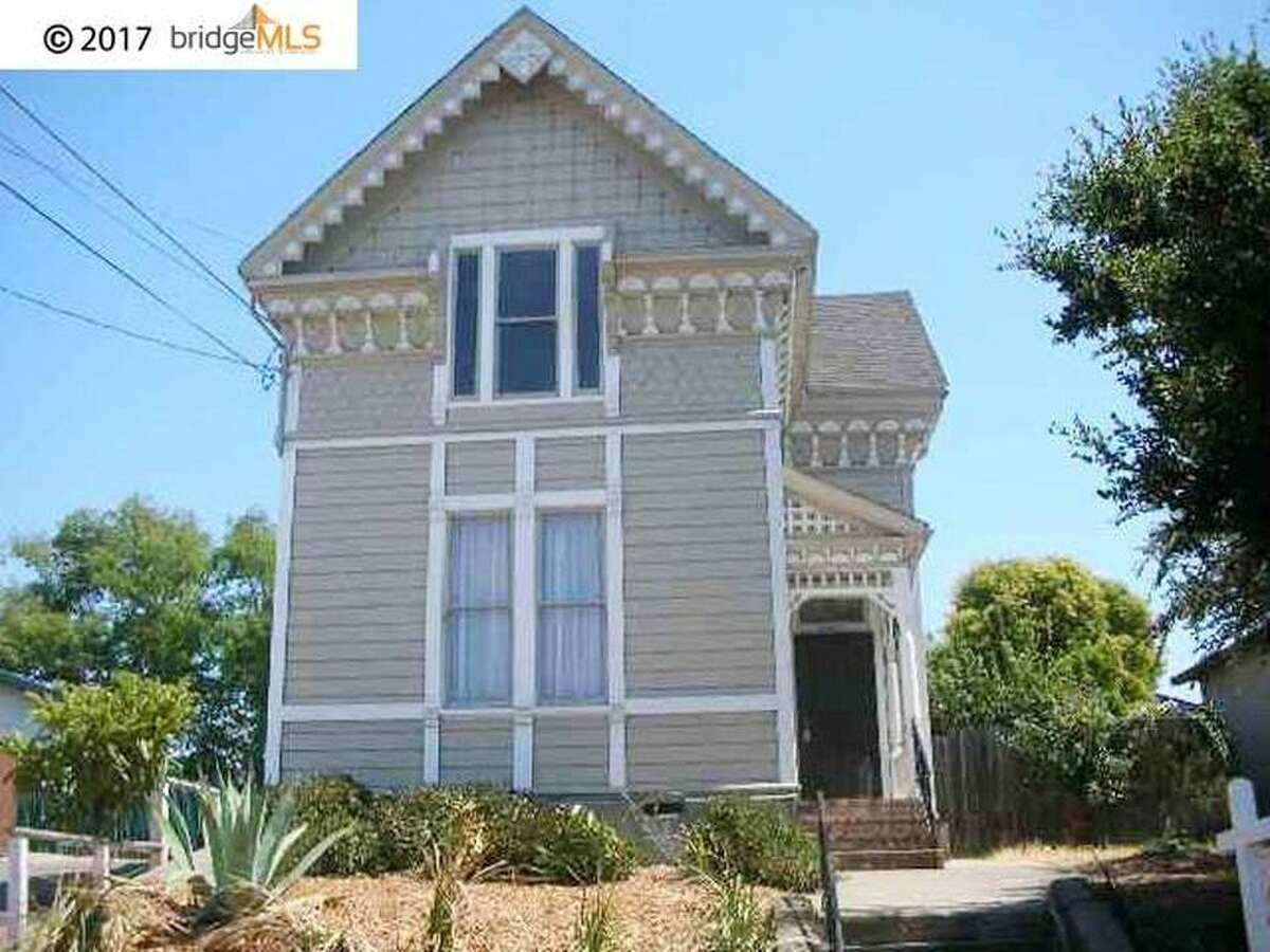 An 1884 Victorian at 1726 19th Ave. in East Oakland is on the market for $499,000. (Note: These photos were taken in 2006 when the property was staged and put on the market but never sold. The home is currently tenant occupied and appears similar with different furnishings.)