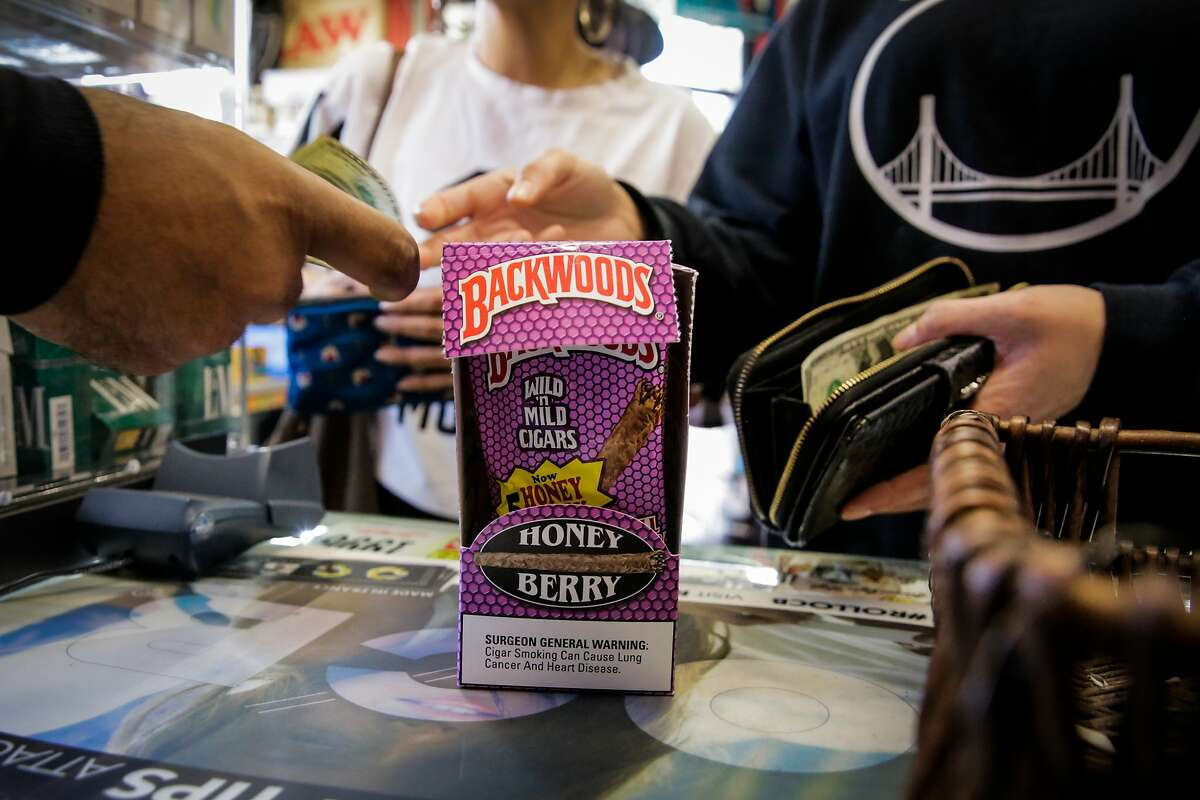 Customer Sierra Narruhn (right) pays for flavored tobacco at City Smoke and Vape Shop in San Francisco, California, on Sunday June 11, 2017. The San Francisco Board of Supervisors voted to keep its ban on selling e-cigarettes and menthol cigarettes, as well as fruit- and candy-tinctured tobacco products.
