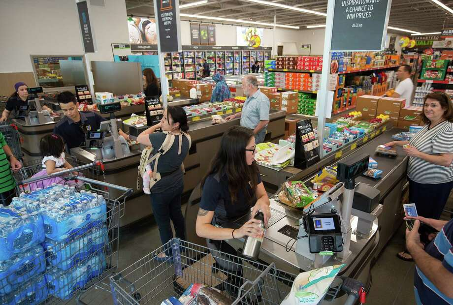 Employees ring up customers at an Aldi Stores Ltd. location in Hackensack, New Jersey, U.S., on Thursday, June 8, 2017. A decades-long supermarket battle in Europe is moving to the U.S., adding to the competitive pressure in an industry embroiled in a deflation-fueledprice war. Aldi, known for low prices on its private-label items, plans to spend $3.4 billion over the next five years to open 900 supermarkets, the company said Monday.Photographer: Michael Nagle/Bloomberg Photo: Michael Nagle / Bloomberg / © 2017 Bloomberg Finance LP