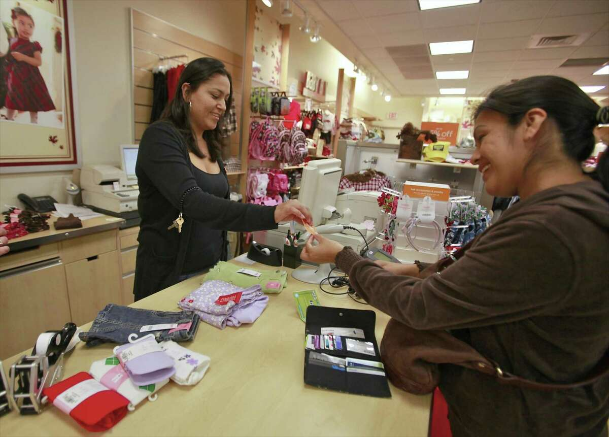 A Gymboree employee in Los Angeles rings up in an order in 2010. In June 2017, the kid's clothing retailer filed for Chapter 11 bankruptcy protection, with plans to close at least 375 of its 1,280 stores, and possibly 400 more. (AP Photo/Damian Dovarganes)