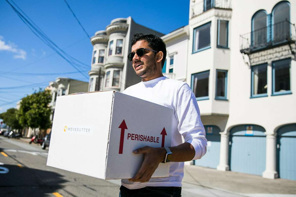 CEO and co-founder of MoveButter, Chai Mishra, delivers a box to his customer in San Francisco, Calif. Monday, June 12, 2017. Mishra often delivers directly to his customers to engage and receive feedback.