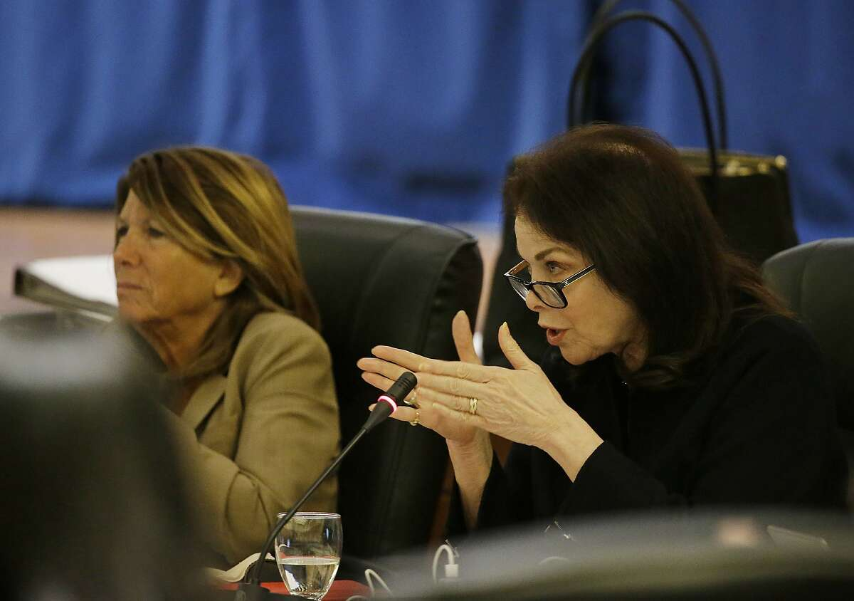 Regent Sherry Lansing, right, questions state auditor Elaine Howle as regent Bonnie Reiss, left, listens during a meeting of the University of California Board of Regents Thursday, May 18, 2017, in San Francisco. California's state auditor briefed the governing board Thursday on findings that UC administrators hid $175 million in a secret reserve fund even as the system raised tuition and sought more public funding. Howle says her office found murky budgeting practices in the office of UC President Janet Napolitano that failed to track expenditures and explain decision-making. (AP Photo/Eric Risberg)