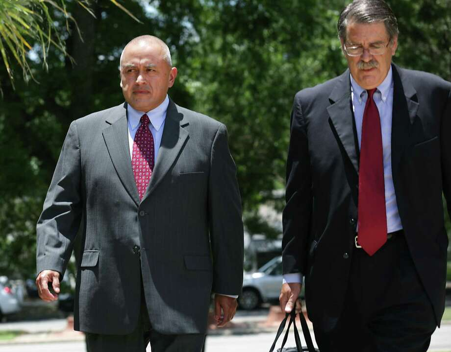 Jimmy Galindo, left, former Reeves County Judge enters the Federal Courthouse on Monday, June 12, 2017, with his lawyer David Botsford.  Galindo pleaded guilty to taking bribes he's alleged to have split with state Sen. Carlos Uresti. Photo: Bob Owen, Staff / San Antonio Express-News / ©2017 San Antonio Express-News