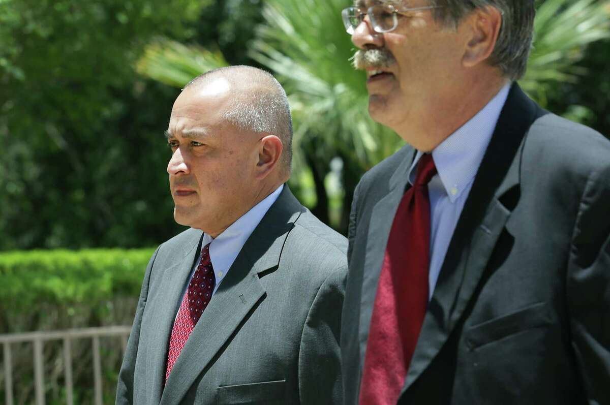 Jimmy Galindo, left, former Reeves County Judge enters the Federal Courthouse on Monday, June 12, 2017, with his lawyer David Botsford. Galindo pleaded guilty to taking bribes he's alleged to have split with state Sen. Carlos Uresti. He had been facing six years in prison; on Tuesday, he was sentenced to a lower term of two and a half years in prison because he cooperated with federal officials.