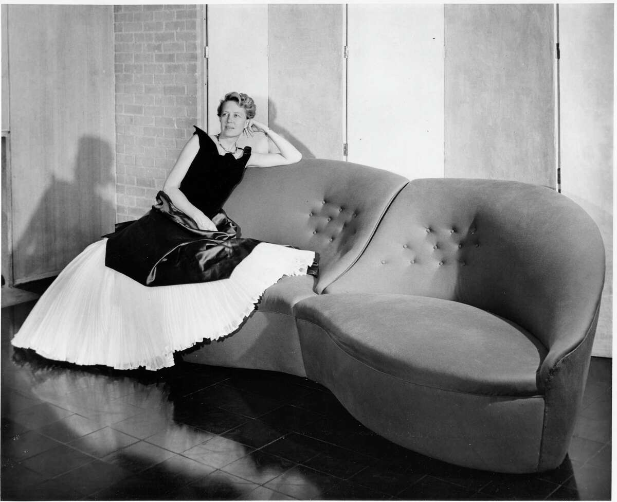 Dominique de Menil in a Charles James gown with [and seated on] a sofa of his design, 1951. The Menil Archives, the Menil Collection, Houston, Courtesy of Charles B. H. James and Louise D. B. James, Photo: F. Wilbur Seiders