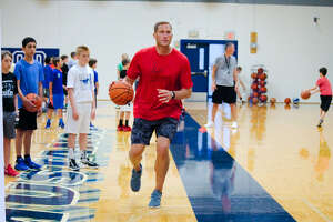 Cliff Owens, new boys' head basketball coach at Friendswood,  demonstrates a drill at the school's summer basketball camp