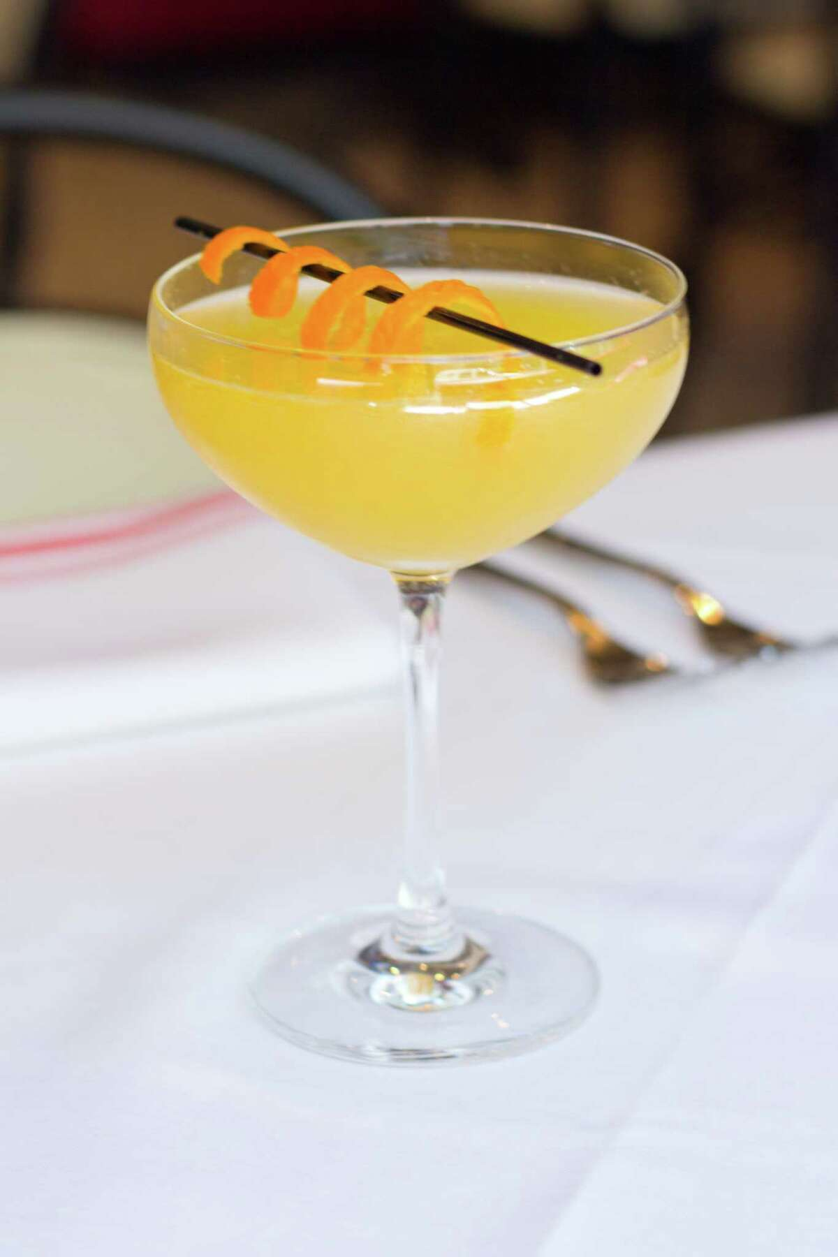 Peachy Keen is a cocktail made with Belvedere vodka, peach liqueur, lemon juice, basil, simple syrup and prosecco. It's among the new cocktails served at Toulouse restaurant in River Oaks District.