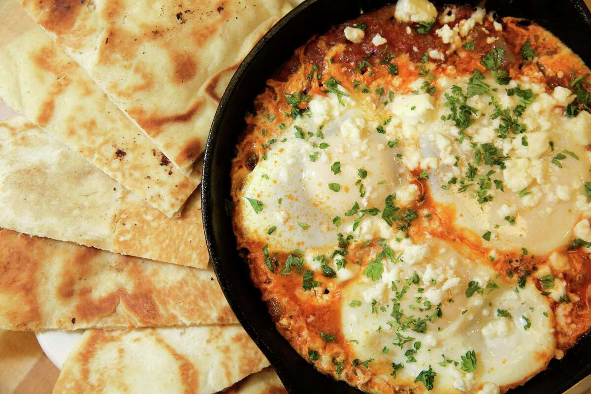 Kenny & Ziggy's Shakshuka is eggs poached in tomato sauce - just adjust the Sriracha heat to your liking.