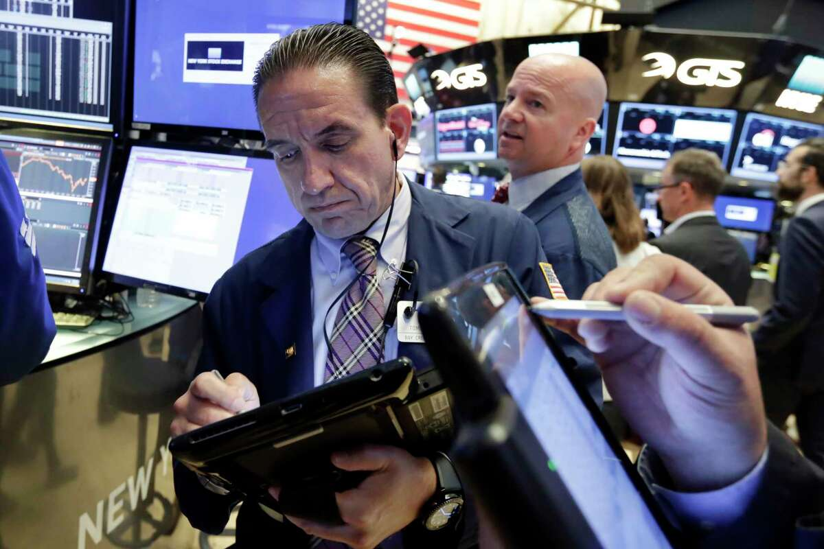 Traders Tommy Kalikas, left, and Patrick Casey work on the floor of the New York Stock Exchange, Monday, June 12, 2017. (AP Photo/Richard Drew)