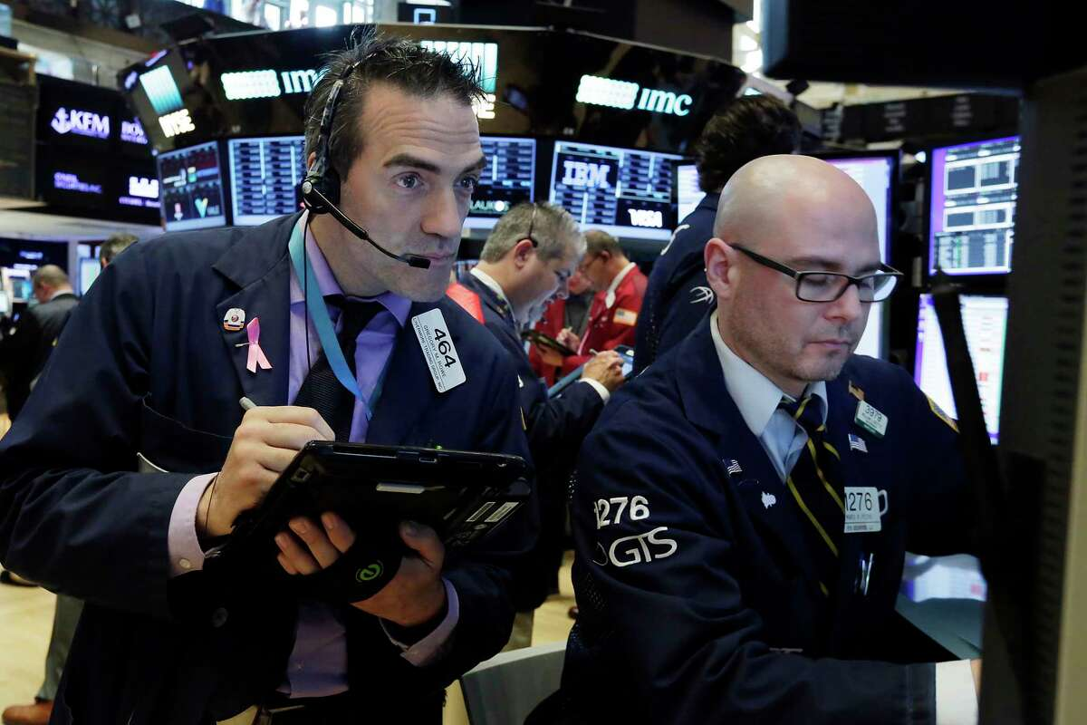 Trader Gregory Rowe, left, and specialist Maria Picone work on the floor of the New York Stock Exchange, Monday, June 12, 2017. (AP Photo/Richard Drew)