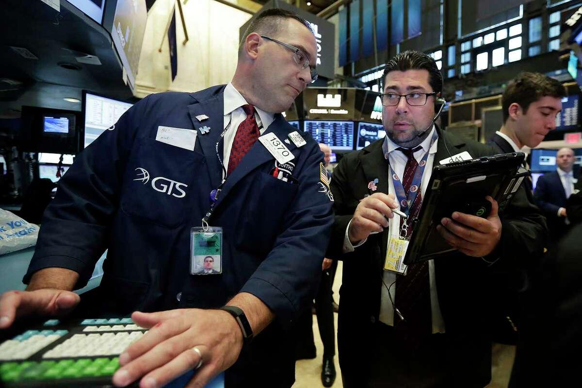 Specialist Anthony Matesic, left, and trader Michael Capolino work on the floor of the New York Stock Exchange, Monday, June 12, 2017. (AP Photo/Richard Drew)