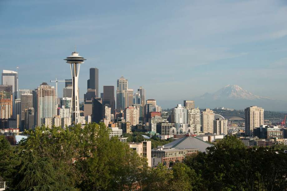 "America's fastest growing city lays on two new titles in city government: We now have a ""Smart City Coordinator"" to go along with a ""Chief Resilience Officer."" Photo: Space Needle"