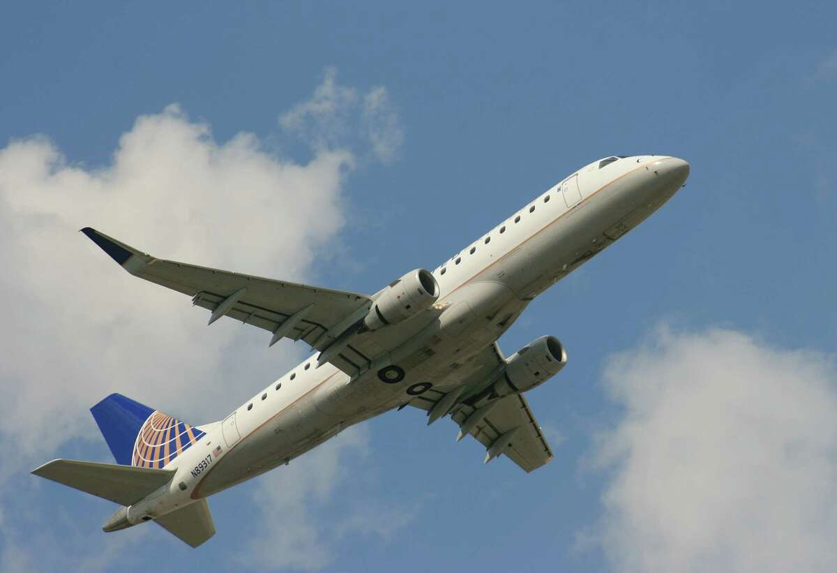 A United Express flight operated by Mesa Airlines takes off from Bush Intercontinental Airport. A tentative deal would bring pilots better benefits.