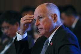 California Gov. Jerry Brown attends the Clean Energy Ministerial International Forum on Electric Vehicle Pilot Cities and Industrial Development, at a hotel in Beijing, Tuesday, June 6, 2017. Brown predicts that President Donald Trump's decision to pull the U.S. out of the Paris climate accord will prove temporary because of the urgency of the issue. He told The Associated Press on the sidelines of a clean energy conference in Beijing on Tuesday that China, Europe and U.S. state governors will for now fill the gap left by the federal government's move to abdicate leadership on the issue. (AP Photo/Andy Wong)